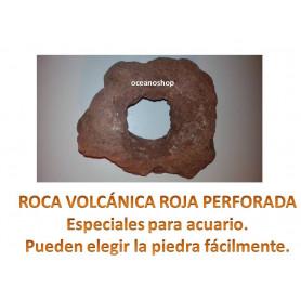 Roca volcanica roja perforada